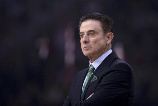 File-This Jan. 4, 2019, file photo shows Panathinaikos coach Rick Pitino looking on during a Euroleague basketball match between Panathinaikos and Olympiakos in Piraeus near Athens. Former Louisville basketball coach Pitino has reached a settlement with Adidas, the Hall of Fame coach and the global sportswear company said in a joint statement Monday, Dec. 23, 2019. (AP Photo/Petros Giannakouris, File)