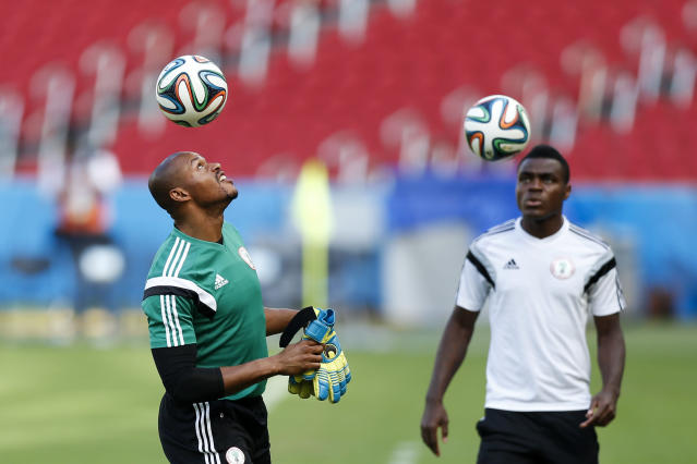 Nigeria's goalkeeper Austin Egide, left, heads the ball during a training session at Beira-Rio Stadium in Porto Alegre, Brazil, Tuesday, June 24, 2014. Nigeria plays in group F of the 2014 soccer World Cup. (AP Photo/Victor R. Caivano)