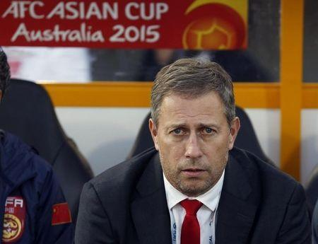 China's coach Alain Perrin looks on before the start of their Asian Cup Group B soccer match against North Korea at the Canberra stadium in Canberra January 18, 2015. REUTERS/Tim Wimborne