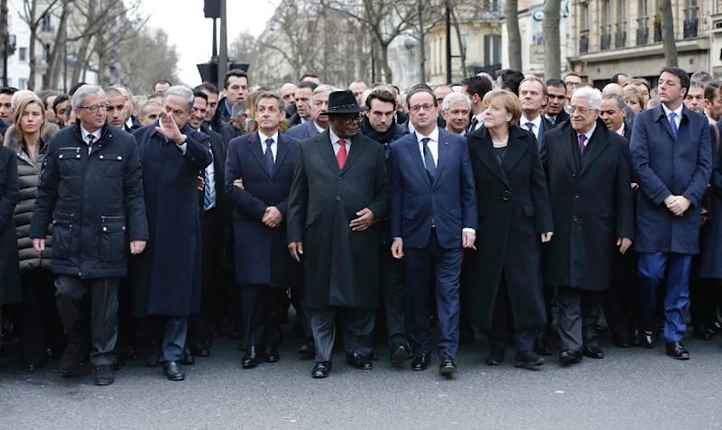 French President Francois Hollande is surrounded by head of states at a solidarity march in Paris in tribute to victims following the shootings at Charlie Hebdo, and a supermarket at the Porte de Vincennes (AFP Photo/Philippe Wojazer)