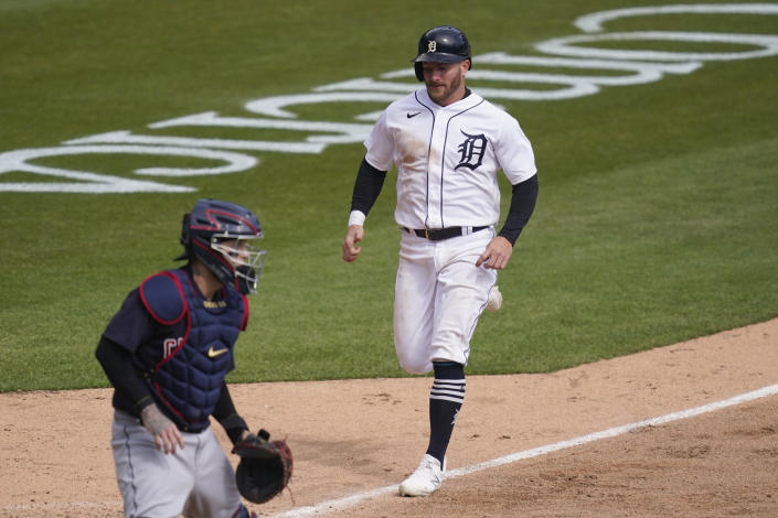 Detroit Tigers' Robbie Grossman scores on a sacrifice fly to right by Jonathan Schoop during the seventh inning of a baseball game against the Cleveland Indians, Saturday, April 3, 2021, in Detroit. (AP Photo/Carlos Osorio)