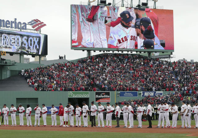 Boston Red Sox's Mookie Betts is displayed on the video sign as he joins teammates in a ceremony to receive their World Series rings before the home opener baseball game between the Red Sox and the Toronto Blue Jays, Tuesday, April 9, 2019, in Boston. (AP Photo/Charles Krupa)