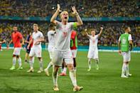 Switzerland's Granit Xhaka leads the celebrations after their victory over the world champions