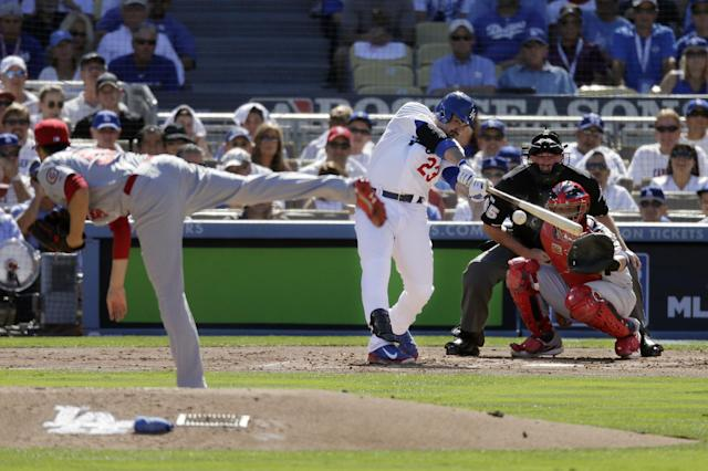 Los Angeles Dodgers' Adrian Gonzalez hits a single off St. Louis Cardinals starting pitcher Joe Kelly during the second inning of Game 5 of the National League baseball championship series Wednesday, Oct. 16, 2013, in Los Angeles. (AP Photo/Chris Carlson)