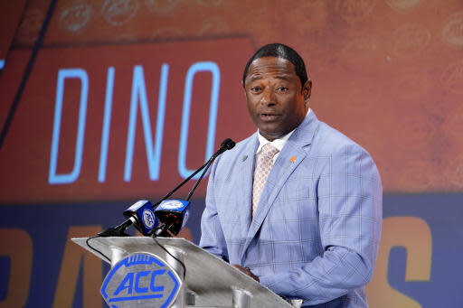 FILE - In this July 17, 2019, file photo, Syracuse head coach Dino Babers speaks during the Atlantic Coast Conference NCAA college football media day in Charlotte, N.C. Babers begins his fourth season at Syracuse with one main goal _ to prove that last season was no fluke. Syracuse finished 10-3 in 2018, second to national champion Clemson in the Atlantic Coast Conference's tough Atlantic Division, and was No. 15 in the AP's final poll.(AP Photo/Chuck Burton, File)