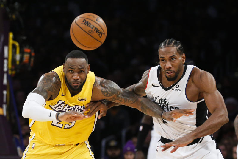 Los Angeles Lakers' LeBron James and Los Angeles Clippers' Kawhi Leonard led Christmas Day ratings. (AP Photo/Ringo H.W. Chiu)