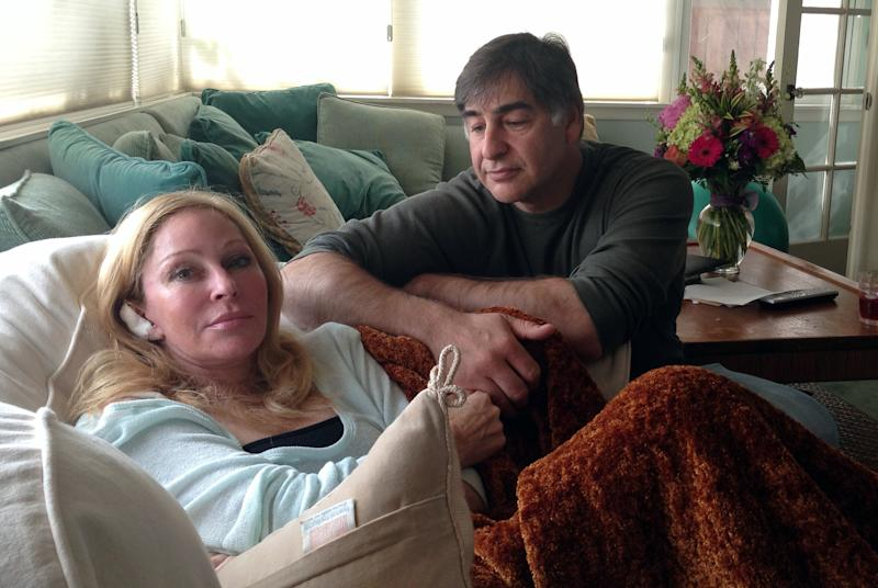 Debra and Russell Fine pose for a photo Sunday, June 9, 2013 in Santa Monica, Calif. Debra Fine, who was wounded Friday when shooting suspect John Zawahri went on a deadly rampage in Santa Monica, was released in good condition late Saturday from Ronald Reagan UCLA Medical Center, according to a hospital statement. Bullets missed his wife's vital organs by inches, Russell Fine told the AP Sunday. (AP Photo/Tami Abdollah)