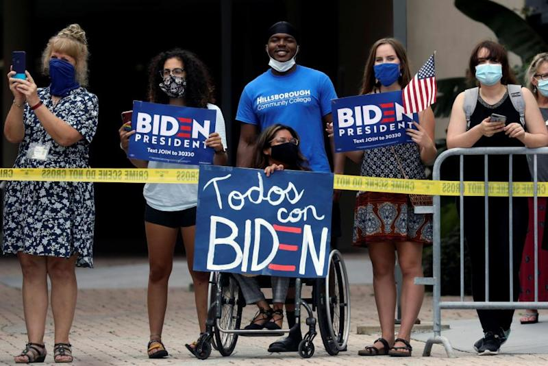 Joe Biden delivers remarks and holds a roundtable discussion with veterans at Hillsborough Community College in Tampa, Florida, as his supporters stand outside on 15 September.
