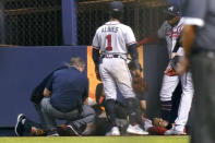 Atlanta Braves right fielder Ronald Acuna Jr., lies on the field after trying to make a catch on an inside-the-park home run hit by Miami Marlins' Jazz Chisholm Jr. during the fifth inning of a baseball game Saturday, July 10, 2021, in Miami. (AP Photo/Lynne Sladky)
