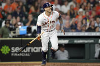 Houston Astros' Carlos Correa watches his RBI ground-rule double against the Chicago White Sox during the fourth inning of a baseball game Thursday, June 17, 2021, in Houston. (AP Photo/David J. Phillip)