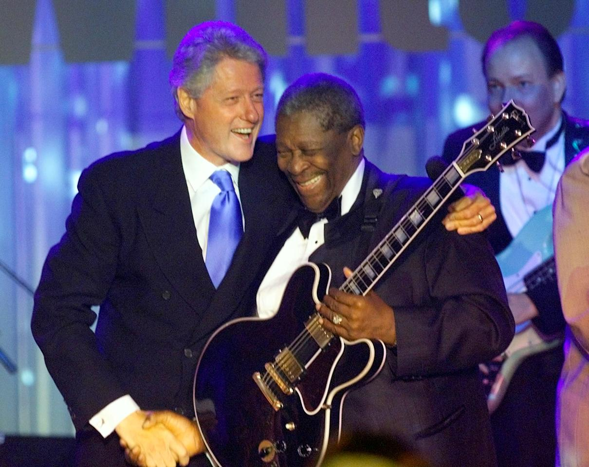 "U.S. President Bill Clinton hugs famous blues guitarist B.B.King after a taping of the WETA ""In Performance at the White House"" program July 28, 1999. (REUTERS/Mark Wilson)"