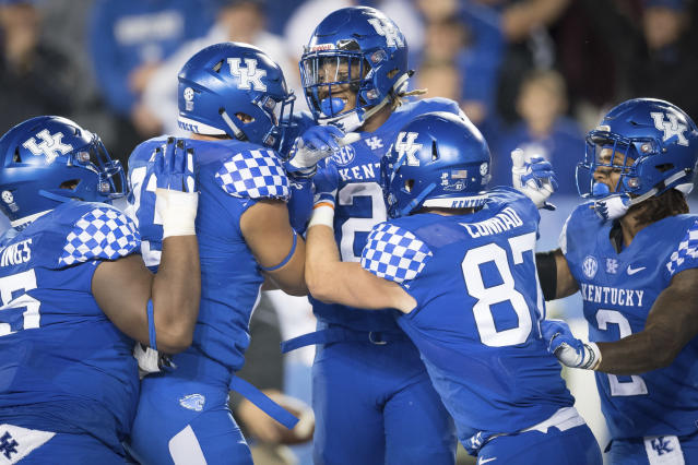 Kentucky running back Benny Snell Jr. (26) celebrates with teammates after scoring a touchdown during the second half of an NCAA college football game against Mississippi State in Lexington, Ky., Saturday, Sept. 22, 2018. (AP Photo/Bryan Woolston)