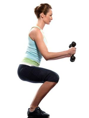 """<div class=""""caption-credit""""> Photo by: Getty Images/iStockphoto</div><div class=""""caption-title"""">Booty Buster</div>Bend your knees slightly and hold a pair of dumbbells on the front of your thighs, palms face-down. Move your hips back until you feel a good stretch in your hamstrings. Then reverse the motion by contracting your glutes and hamstrings. Extend your hips and stand up, returning to starting position. Your back should be flat, chest up, chin tucked, and shoulders down the entire time. Do three sets of eight to ten reps. <br> <br> Targets: Hamstrings, Glutes & Lower Back <br> <br> <b>Related: <a rel=""""nofollow"""" href=""""http://www.cosmopolitan.com/advice/health/drop-5-pounds-in-a-week-0509?link=emb&dom=yah_life&src=syn&con=blog_cosmo&mag=cos"""" target=""""_blank"""">Drop 5 Pounds in a Week</a></b> <br> <b>Related: <a rel=""""nofollow"""" href=""""http://www.cosmopolitan.com/advice/health/right-way-to-lose-weight?link=emb&dom=yah_life&src=syn&con=blog_cosmo&mag=cos"""" target=""""_blank"""">The Right Way to Lose Weight</a></b> <br> <br>"""