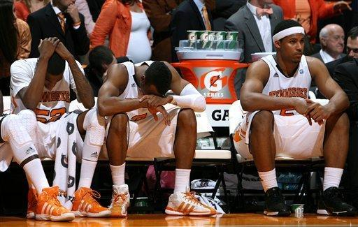 Tennessee players, from left, Jordan McRae (52), Renaldo Woolridge (3) and Jarnell Stokes (5) react as Kentucky wins 65-62 in an NCAA college basketball game at Thompson-Boling Arena in Knoxville, Tenn., Saturday, Jan. 14, 2012. (AP Photo/Knoxville News Sentinel, Adam Brimer)