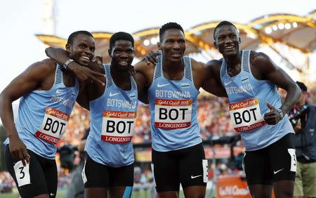 Athletics - Gold Coast 2018 Commonwealth Games - Men's 4x400m - Final - Carrara Stadium - Gold Coast, Australia - April 14, 2018. Isaac Makwala, Leaname Maotoanong, Baboloki Thebe and Onkabetse Nkobolo of Botswana celebrate after winning the race. REUTERS/Paul Childs