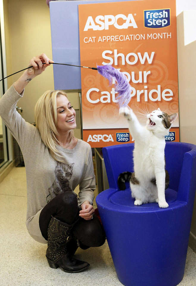 Later, Kelly made some time to play around with another adorable cat in attendance. Meow!