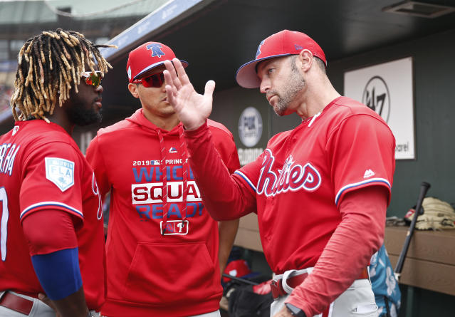 Philadelphia Phillies center fielder Odubel Herrera, left, and Philadelphia Phillies manager Gabe Kapler, right, talk in the dugout in the fourth inning during an exhibition spring training baseball game against the St. Louis Cardinals on Monday, March 18, 2019, in Jupiter, Fla. (AP Photo/Brynn Anderson)