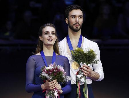Figure Skating - ISU European Championships 2018 - Ice Dance Victory Ceremony - Moscow, Russia - January 20, 2018 - Gold medallists Gabriella Papadakis and Guillaume Cizeron of France attend the ceremony. REUTERS/Grigory Dukor