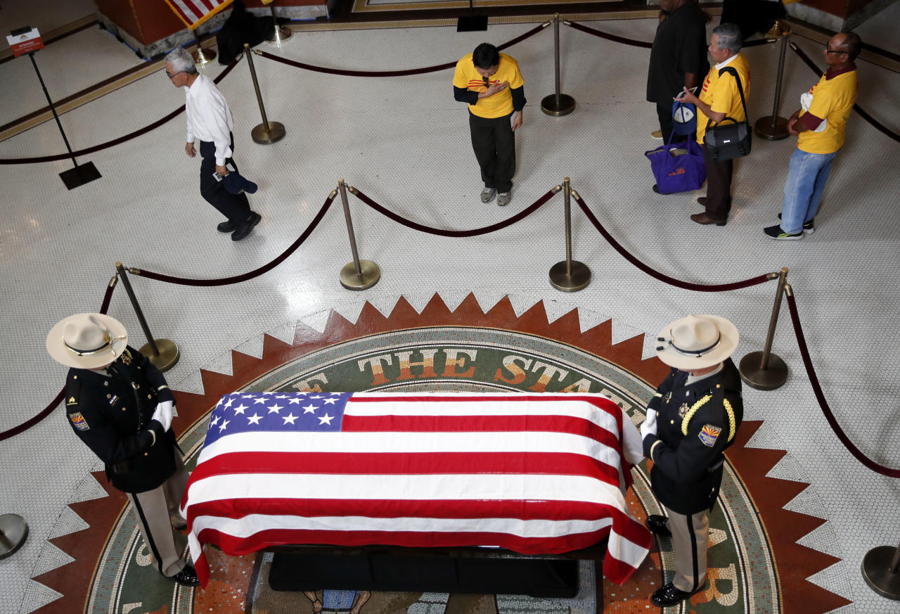 <p>A Vietnamese group from Orange County, Calif., pays their respects near the casket of Sen. John McCain during a viewing at the Arizona Capitol on Wednesday, Aug. 29, 2018, in Phoenix. (Photo: Jae C. Hong/AP) </p>