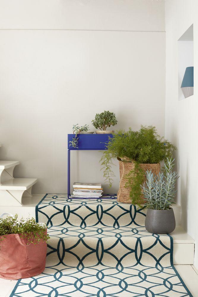 """<p>Implement pattern into your home with an eye-catching carpet runner, such as this hand-woven style from Jennifer Manners. It's a charming, playful pattern that will really work well alongside a white or neutral staircase.</p><p>Pictured: Tiles runner in Teal, £2,020, <a href=""""https://jennifermanners.co.uk/"""" rel=""""nofollow noopener"""" target=""""_blank"""" data-ylk=""""slk:Jennifer Manners"""" class=""""link rapid-noclick-resp"""">Jennifer Manners</a>; Plant stand by Ferm Living, £179, <a href=""""https://www.heals.com/"""" rel=""""nofollow noopener"""" target=""""_blank"""" data-ylk=""""slk:Heal's"""" class=""""link rapid-noclick-resp"""">Heal's</a>; Hemp storage basket, £69.95, <a href=""""https://www.oggetto.com/"""" rel=""""nofollow noopener"""" target=""""_blank"""" data-ylk=""""slk:Oggetto"""" class=""""link rapid-noclick-resp"""">Oggetto</a>. Black concrete planter, £55 for two, <a href=""""https://www.roseandgrey.co.uk/"""" rel=""""nofollow noopener"""" target=""""_blank"""" data-ylk=""""slk:Rose & Grey"""" class=""""link rapid-noclick-resp"""">Rose & Grey</a>.<br></p>"""