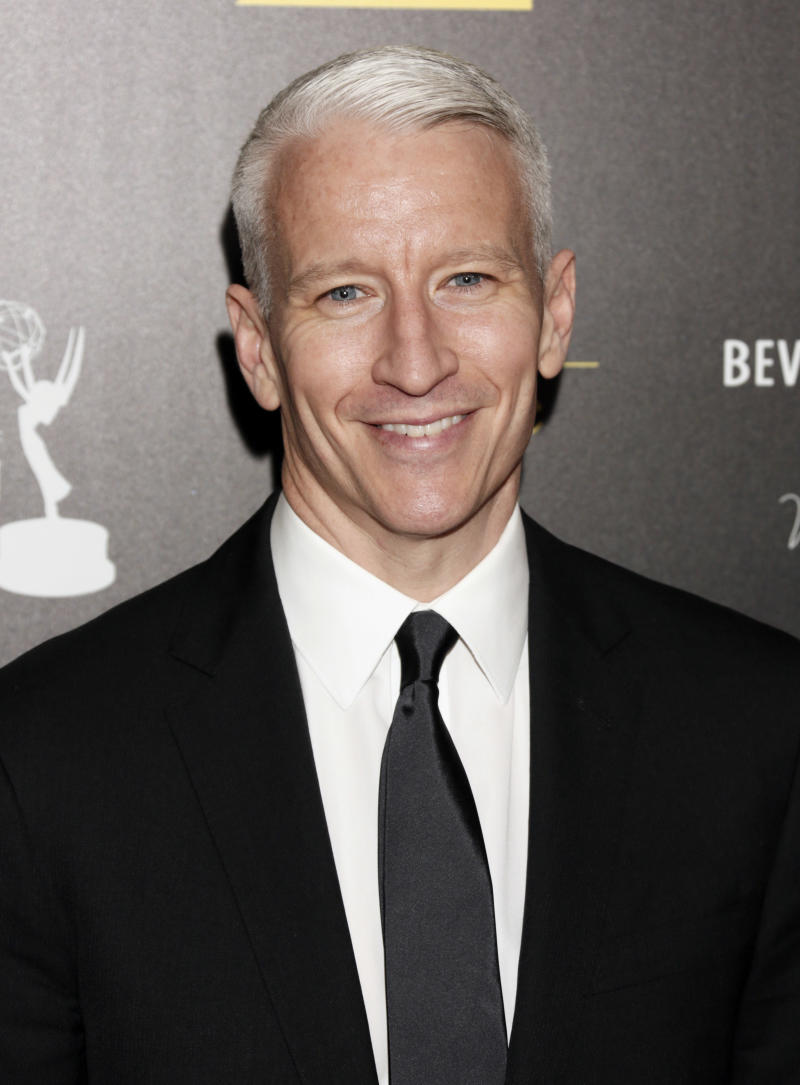 "FILE - This June 23, 2012 file photo shows CNN's Anderson Cooper arrives at the 39th Annual Daytime Emmy Awards at the Beverly Hilton Hotel in Beverly Hills, Calif. Cooper came out in a letter online, saying ""the fact is, I'm gay."" He said Monday, July 2, in a note to the Daily Beast's Andrew Sullivan that he had kept his sexual orientation private for personal and professional reasons, but came to think that remaining silent had given some people an impression that he was ashamed. (Photo by Todd Williamson/Invision/AP, file)"