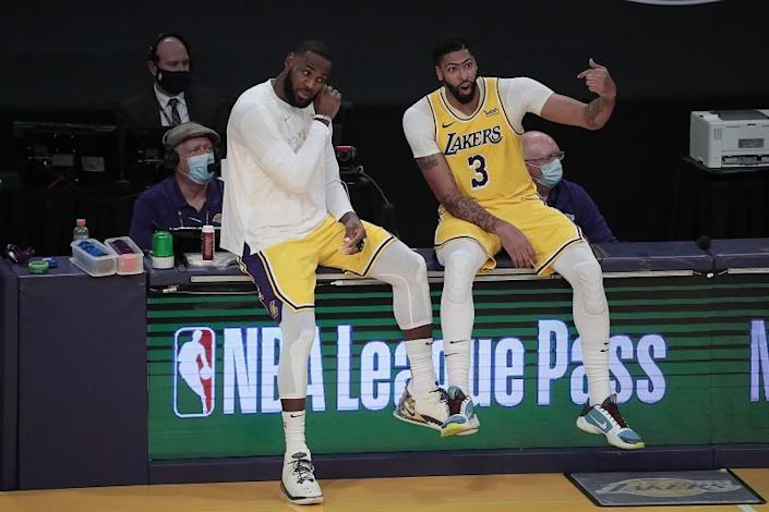 Los Angeles, CA, Tuesday, December 22, 2020 - Los Angeles Lakers forward LeBron James (23) and Los Angeles Lakers forward Anthony Davis (3) talk during a break in the action against the Clippers at Staples Center. (Robert Gauthier/ Los Angeles Times)