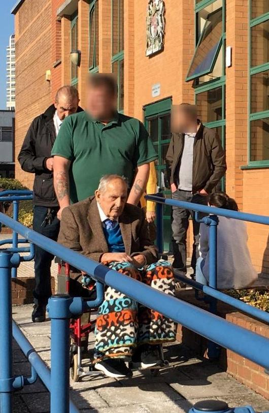 Dennis Cottee (front in wheelchair), with Jacques Cottee, in white shirt and black jacket behind, pictured leaving Swindon Crown Court (SWNS)