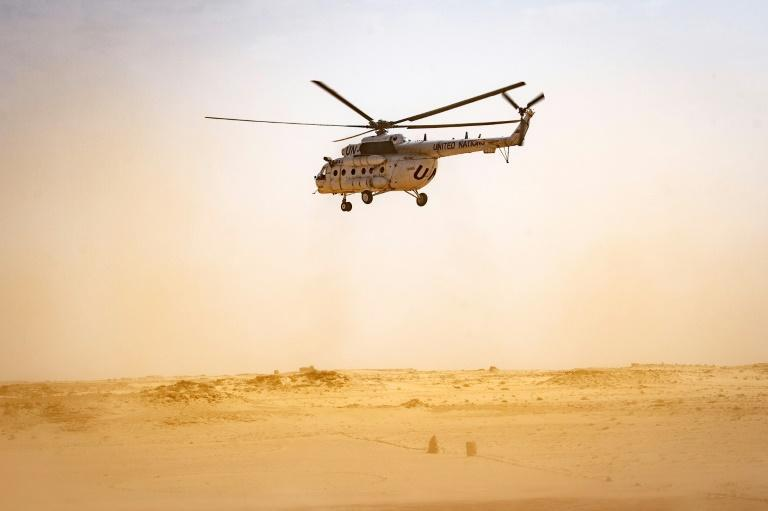 A helicopter from the UN Mission for the Referendum in Western Sahara flies over the divided region on November 25; the force is mandated to hold a vote for self-determination to settle a decades old dispute