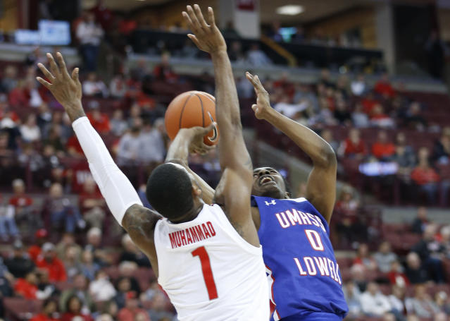 UMass-Lowell's Ron Mitchell, right, tries to shoot over Ohio State's Luther Muhammad during the first half of an NCAA college basketball game Sunday, Nov. 10, 2019, in Columbus, Ohio. (AP Photo/Jay LaPrete)