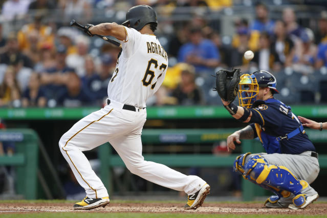 The pitch to Pittsburgh Pirates' Dario Agrazal gets away from Milwaukee Brewers catcher Yasmani Grandal as Agrazal tried to bunt during the fourth inning of a baseball game, Saturday, July 6, 2019, in Pittsburgh. Elias Diaz advanced to second on the play. (AP Photo/Keith Srakocic)