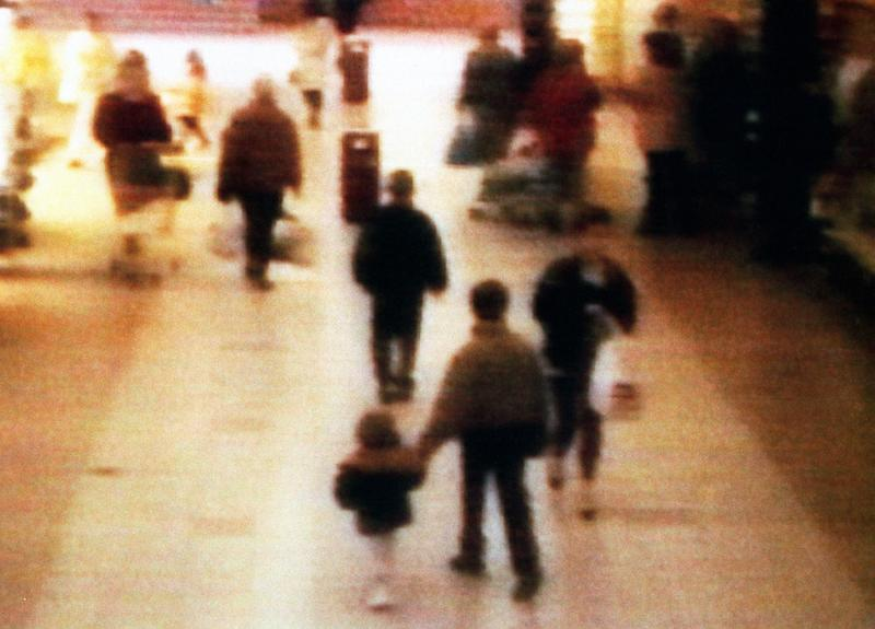 Chilling: A video still of missing boy James Bulger, aged 2 years old, being led away in the 'New Strand' shopping centre in the Bootle area of Liverpool, before he was tortured and killed. (PA)