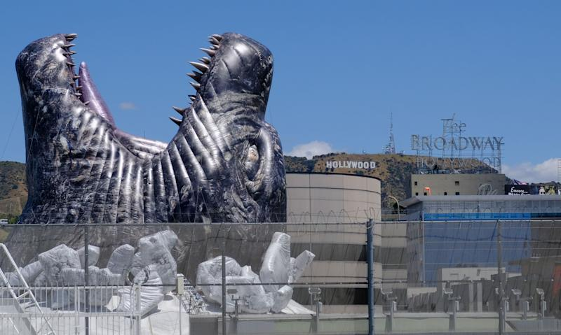 A giant Godzilla is seen bursting through the roof of the Cinerama Dome in Hollywood on May 20, 2019. - The movie Godzilla King of the Monsters is set to release on May 31, 2019. (Photo by Chris Delmas / AFP) (Photo credit should read CHRIS DELMAS/AFP/Getty Images)
