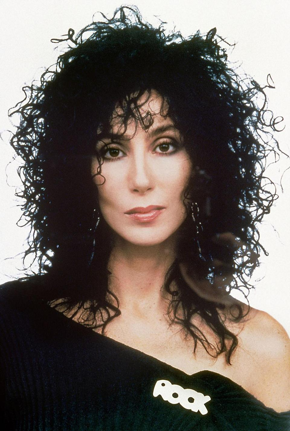 <p>Also from 1987 is this classic, with Cher sporting the wet look, smoky eyes, and a classic off-the-shoulder top. <i>(Photo: Everett Collection)</i></p>