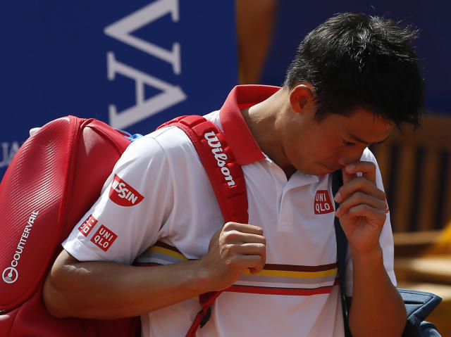 Kei Nishikori of Japan walks off the court as he retires from his match against Guillermo Garcia Lopez during the Barcelona Open Tennis Tournament in Barcelona, Spain, Wednesday, April 25, 2018. (AP Photo/Manu Fernandez)