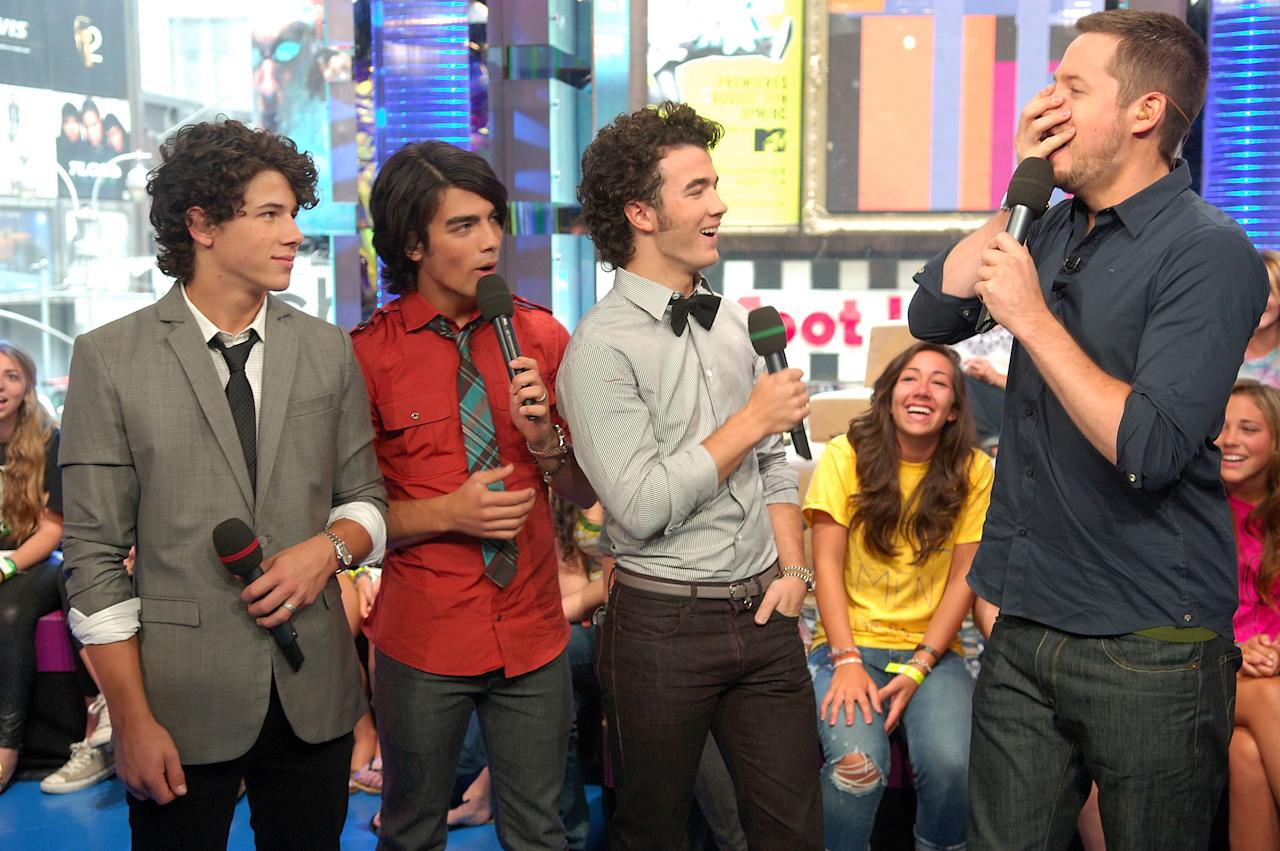 <p>When MTV's <em>TRL</em> came calling, the JoBros were there. They chatted with VJ Damien Fahey on Aug. 11. (Photo: Michael Loccisano/FilmMagic) </p>