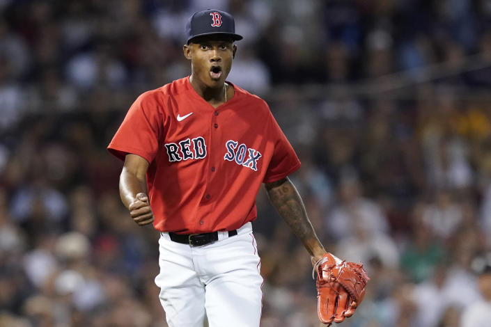 Boston Red Sox relief pitcher Phillips Valdez reacts after striking out New York Yankees' Ryan LaMarre to end the top of the fourth inning of a baseball game at Fenway Park, Friday, July 23, 2021, in Boston. (AP Photo/Elise Amendola)