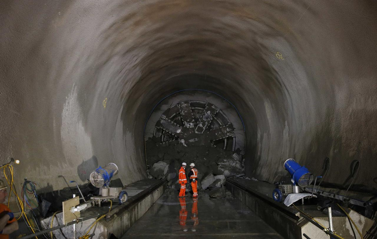 """Crossrail supervisors make checks on the tunnel after """"Victoria"""", a tunnel boring machine broke through at Whitechapel underground station in London April 4, 2014. Crossrail is the largest infrastructure project in Europe, and will provide a new link across London which is due to be completed in 2017. REUTERS/Suzanne Plunkett (BRITAIN - Tags: BUSINESS EMPLOYMENT TRANSPORT)"""