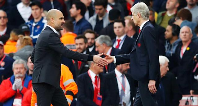 Guardiola and Wenger shake hands after a draw that kept the status quo for both sides. (Reuters)