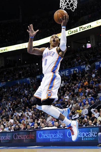 Oklahoma City Thunder guard Russell Westbrook (0) shoots against the Charlotte Bobcats in the second quarter of an NBA basketball game in Oklahoma City, Monday, Nov. 26, 2012. (AP Photo/Sue Ogrocki)