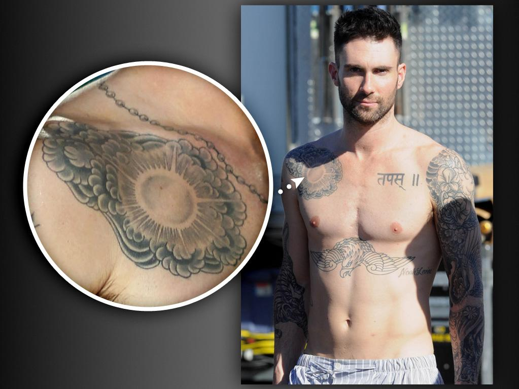"""Adam Levine<br><br> In a recent interview with Anderson Cooper, Adam Levine revealed that the tattoo on his right shoulder is """"pretty stupid."""" When Adam saw a guy with a cool-looking Russian-like tattoo, he tried to mimic it and ended up getting inked with a """"horrible bastardized version"""" instead. In hindsight, he admits he probably shouldn't have gotten the tattoo in the first place because he's """"not tough."""" Adam told Anderson that he tried to hide the tat by surrounding it with something else, but now it just looks like """"a cauliflower with a sun in the middle of it."""""""