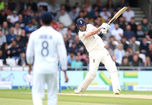 Ollie Robinson, right, is bowled by Jasprit Bumrah, not pictured