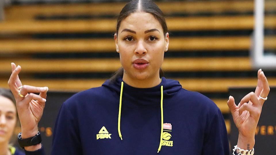 In this photo, Australian Olympic basketball star Liz Cambage chats to the media.