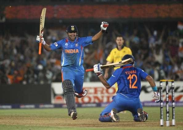 AHMEDABAD, INDIA - MARCH 24: Suresh Raina (L) of India celebrates the winning runs scored by Yuvraj Singh (R) during the 2011 ICC World Cup Quarter-Final match between Australia and India at the Sardar Patel Stadium on March 24, 2011 in Ahmedabad, India. (Photo by Michael Steele/Getty Images)
