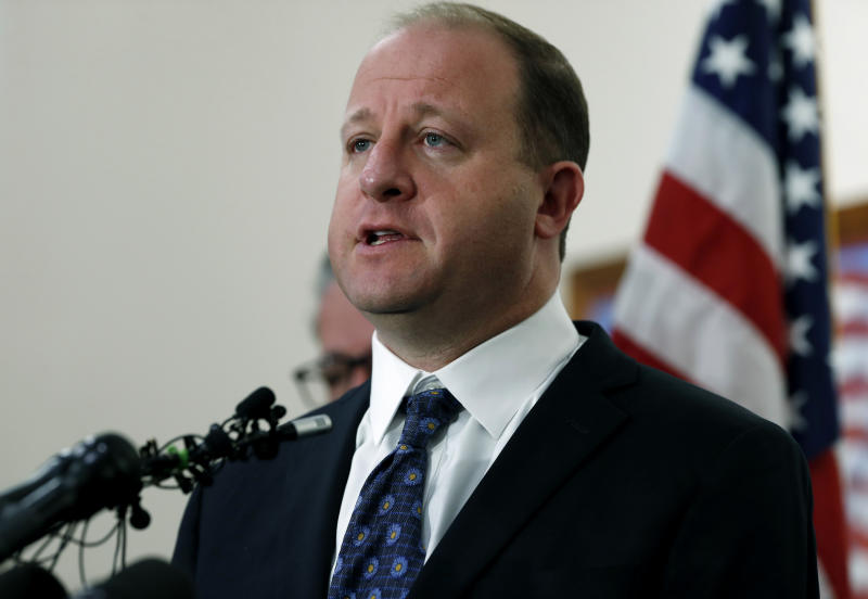 FILE - In this May 8, 2019, file photo, Colorado Gov. Jared Polis responds to a question about a shooting at a charter school during a news conference in Highlands Ranch, Colo. Colorado Republicans who were trounced in the November 2018 elections are using the recall process to try to reclaim seats and some political power. Gov. Polis, who defeated his opponent by 11 percentage points, is one target. (AP Photo/David Zalubowski, File)