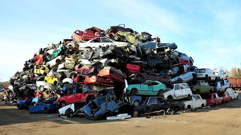 Pile of cars in the junkyard waiting for recycling