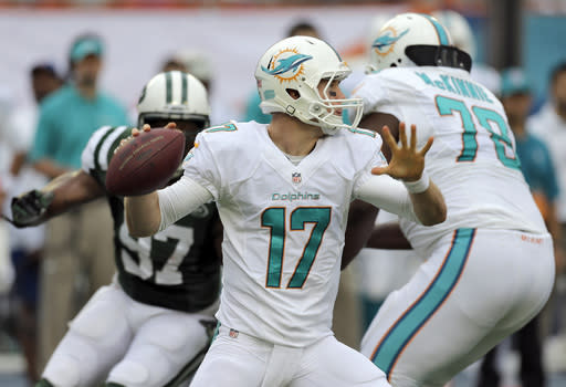 Miami Dolphins quarterback Ryan Tannehill (17) throws a pass against the New York Jets during the first quarter of an NFL football game Sunday, Dec. 29, 2013, in Miami Gardens, Fla. (AP Photo/Chris O'Meara)