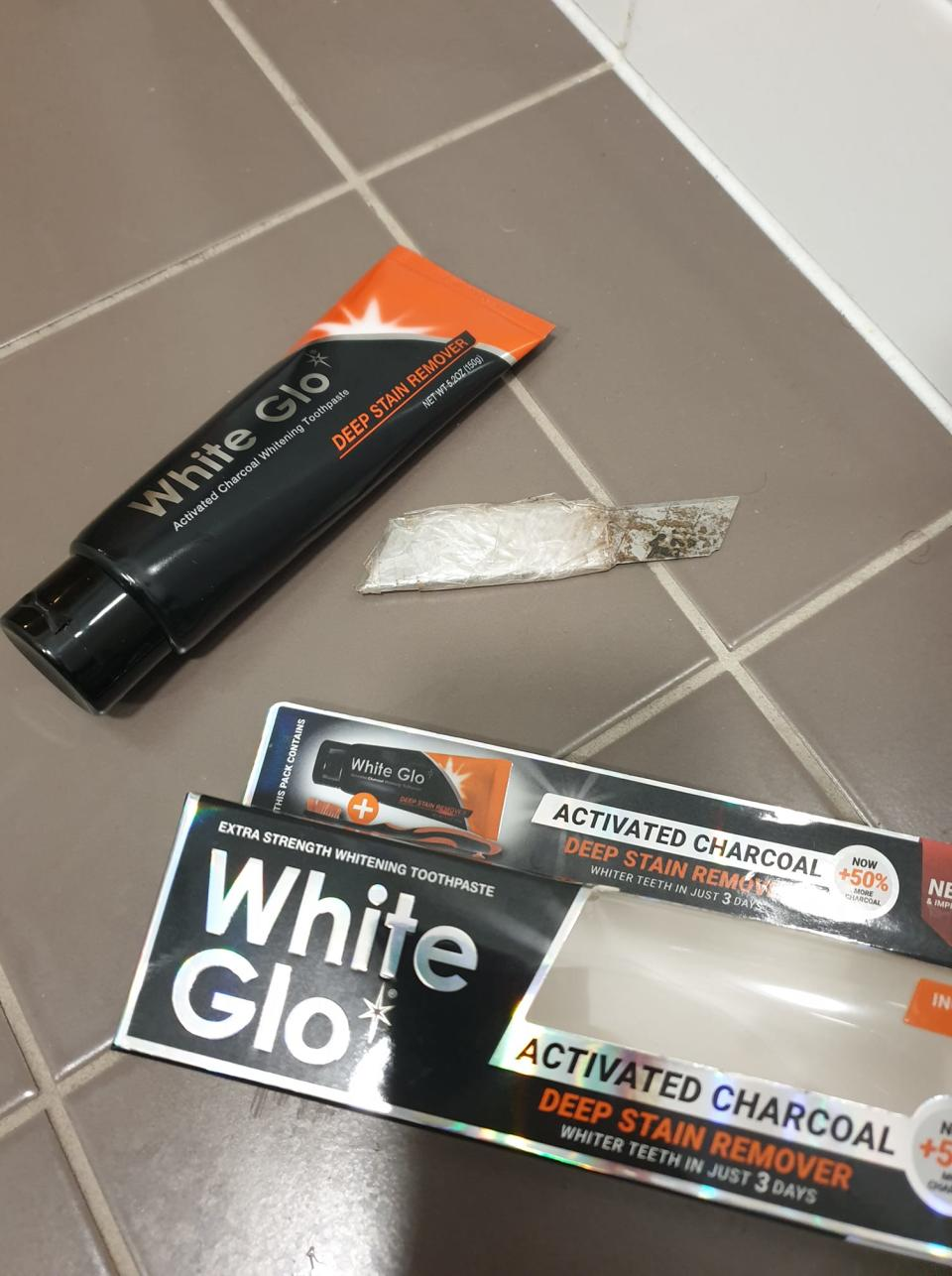 Tube of White Glo toothpaste and box with razor blade next to it. Source: Facebook