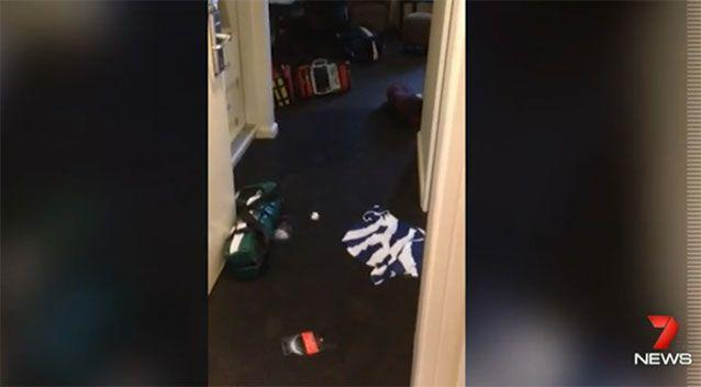 Police footage shows clothes strewn across the floor of the hotel room. Photo: 7 News