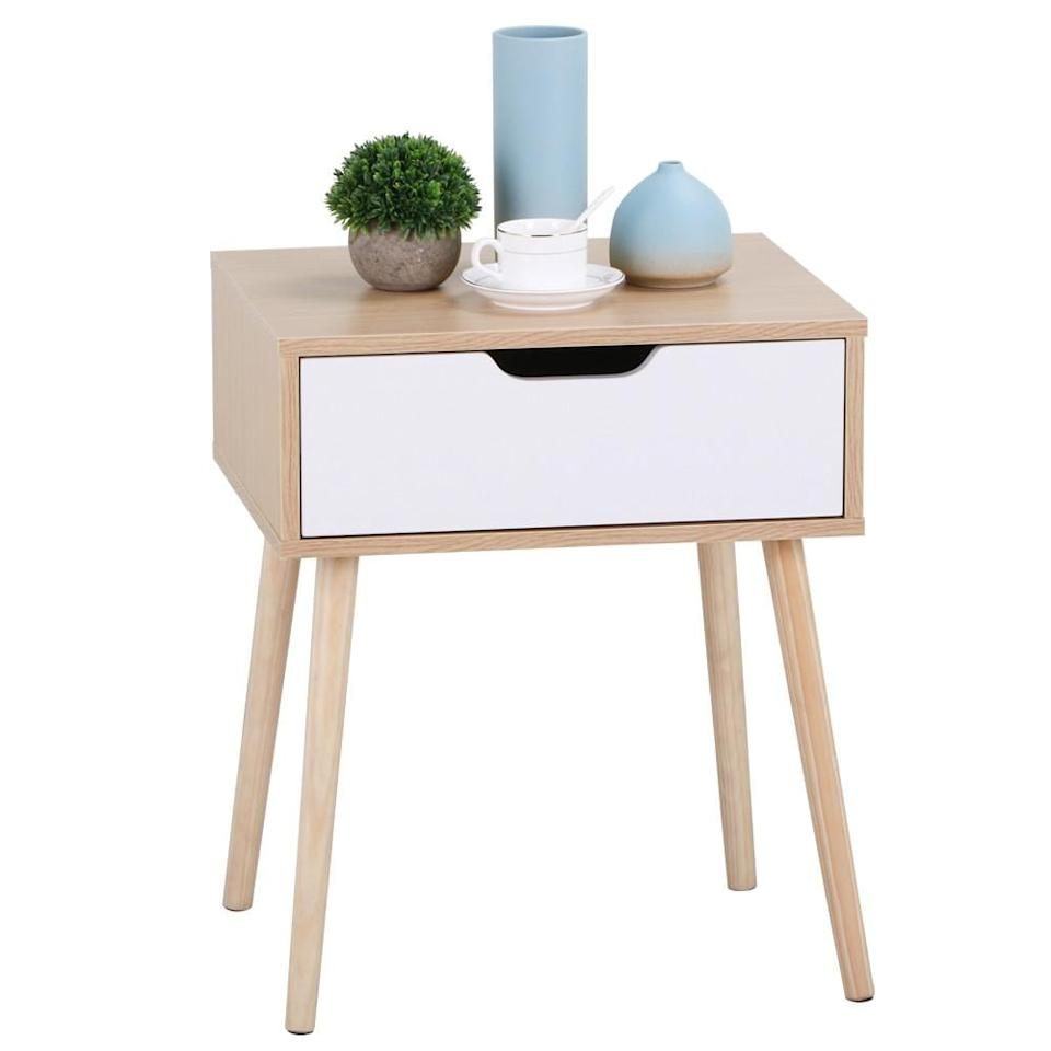 "<p>You can't go wrong with this <a href=""https://www.popsugar.com/buy/White%2FBrown%20Walnut%20Side%20End%20Table%20Nightstand%20With%20Storage%20Drawer-469586?p_name=White%2FBrown%20Walnut%20Side%20End%20Table%20Nightstand%20With%20Storage%20Drawer&retailer=walmart.com&price=38&evar1=casa%3Aus&evar9=46394007&evar98=https%3A%2F%2Fwww.popsugar.com%2Fhome%2Fphoto-gallery%2F46394007%2Fimage%2F46394270%2FWhiteBrown-Walnut-Side-End-Table-Nightstand-Storage-Drawer&list1=shopping%2Cfurniture%2Cwalmart&prop13=api&pdata=1"" rel=""nofollow"" data-shoppable-link=""1"" target=""_blank"" class=""ga-track"" data-ga-category=""Related"" data-ga-label=""https://www.walmart.com/ip/White-Brown-Walnut-Side-End-Table-Nightstand-with-Storage-Drawer-Solid-Wood-Legs-Living-Room-Furniture/426287260"" data-ga-action=""In-Line Links"">White/Brown Walnut Side End Table Nightstand With Storage Drawer</a> ($38). Use it as either a nightstand or side table for your couch.</p>"
