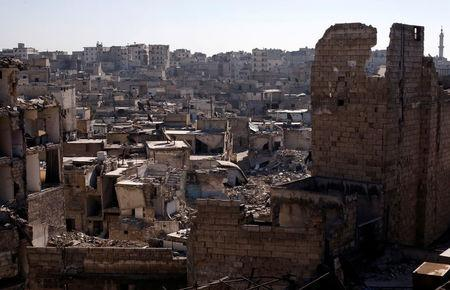 A general view shows damaged buildings at al-Kalasa district of Aleppo